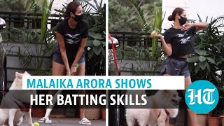 Watch: Actor Malaika Arora plays cricket with son Arhaan