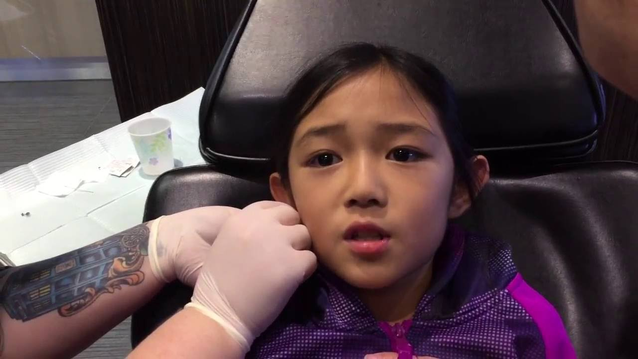 Painless Ear Piercing By Needle Youtube