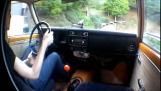 datsun 510 driving up a hill