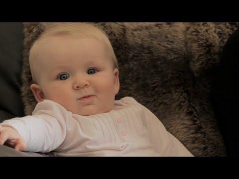 Cute baby winks at camera