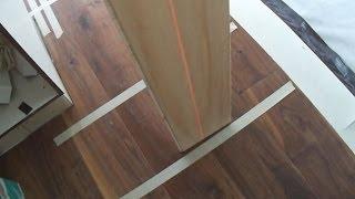 Engineered Hardwood Floating Floor Installation In A Long Hallway