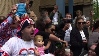Cheers and champagne as fans learn royal baby is a boy