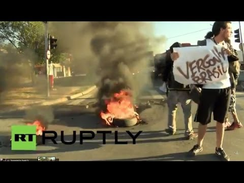"Brazil: Tyres burn in ""Shame on Brazil"" protest as World Cup kicks off"