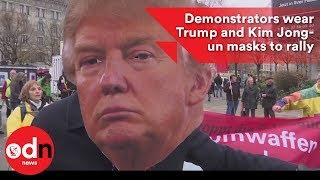 2017-11-18-18-17.Demonstrators-wear-Trump-and-Kim-Jong-Un-masks-to-rally