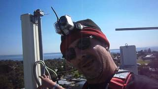 The Mad Bushman climbs a telecommunication tower