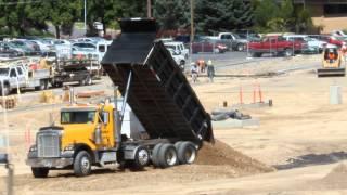 Double Dump Truck dumping dirt
