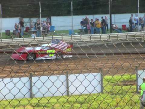 Kristin Flory in The Hodges Cafe u2 carring the American Flag at Lakeville Speedway June 18 2010