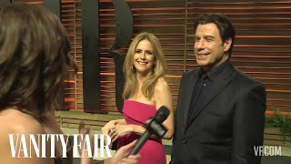 John Travolta and Kelly Preston at the 2014 Vanity Fair Oscar Party-V.F. Academy Awards Party