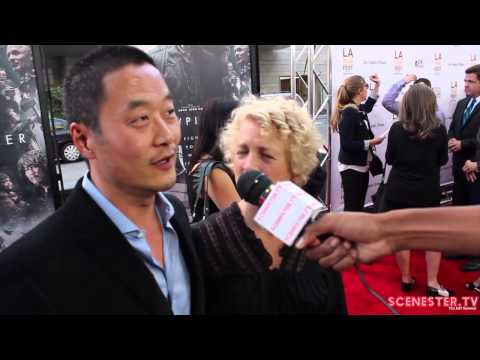 Actor Steve Park & Kelly Park at SNOWPIERCER movie premiere at LA Film Fest