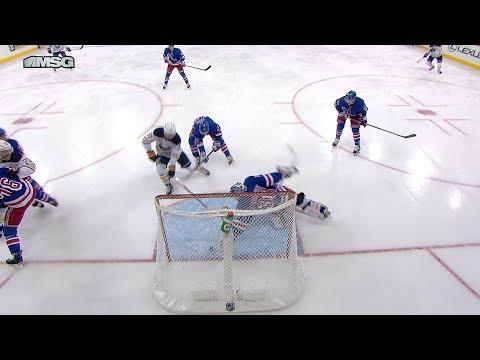 Henrik Lundqvist dives to swat a puck off the goal line