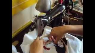 Bordando em uma máquina simples de pedal