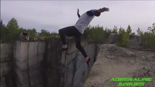 Adrenaline Junkies HD - 82 foot gainer goes TERRIBLY wrong while cliff jumping!