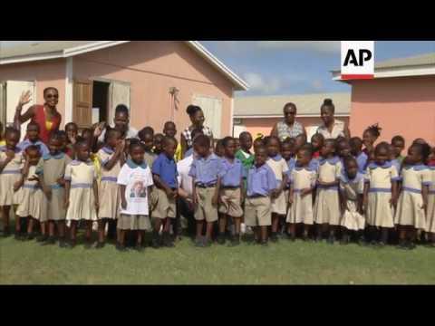 Prince Harry visits Barbuda, meets students