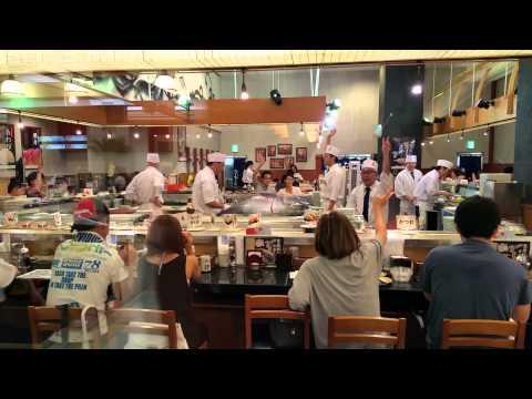 Tokyo sushi bar public tuna butchering