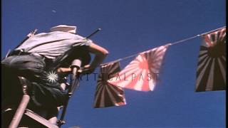 Crew of US Submarine decorates their boat on VJ Day (Victory over Japan) in Pearl...HD Stock Footage