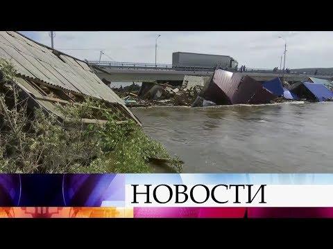"""В Иркутской области восстановили движение по федеральной трассе """"Сибирь""""."""