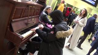 Hoodie on Piano Captivates Mystery Girl