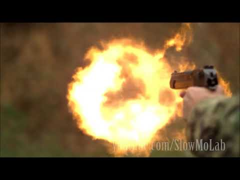 (ultra SloMo) GUN RECOIL is gas forced into atmosphere
