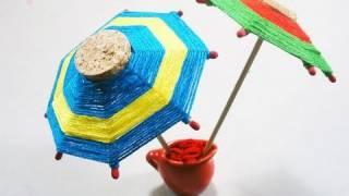 Como hacer una sombrilla o paraguas de corchos e hilos :) - manualidadesconninos