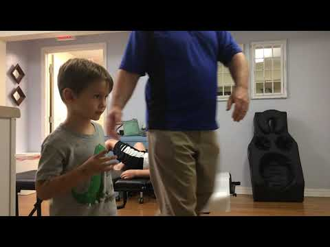Dr. Joshua Ledbetter, D.C. gives his kids an adjustment | Wesley Chapel Chiropractor