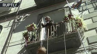 Sharing is caring   Italian man feeds homeless from his balcony amid lockdown