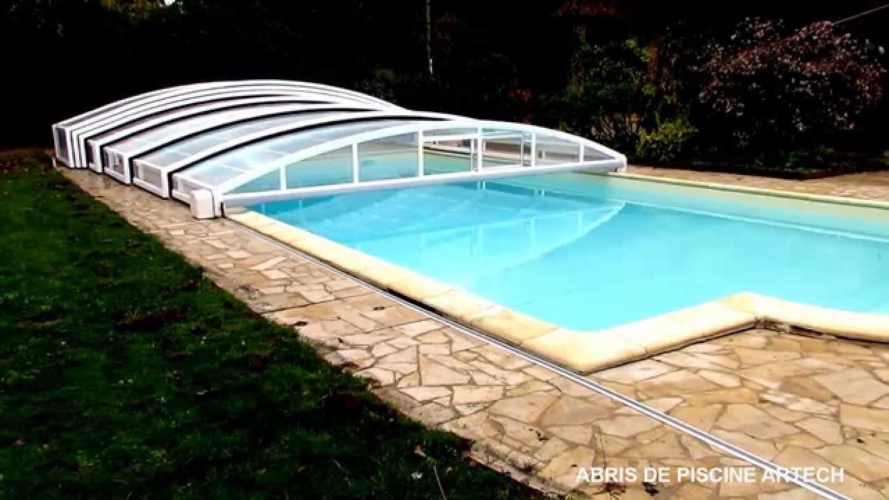 Abri de piscine coulissant motorise par abris artech for Abri de piscine bas motorise