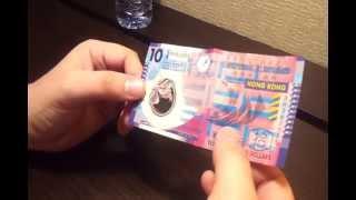 Порвать пластиковую купюру в $10