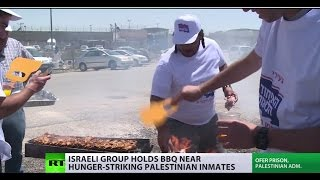 Cooking up trouble? Israeli activists stage BBQ near hunger-striking Palestinian inmates