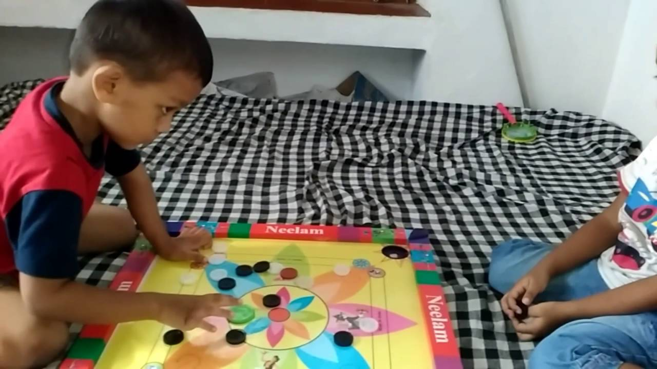 Carrom playing activities by kids - YouTube
