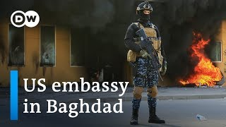 US troops fire tear gas at pro-Iran protesters at Baghdad embassy | DW News