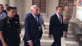 Najib arrives at court, charged over 1MDB audit report 'tampering'