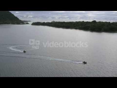 tracking extreme wide shot of jet boats on water vanuatu ejqxb9zuz