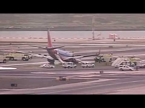 Plane touches down without landing gear at New York's LaGuardia airport