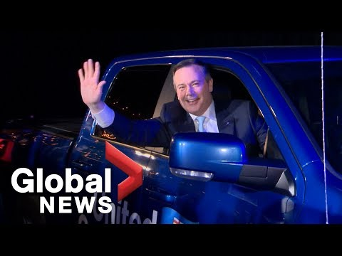 Jason Kenney arrives at UCP party in truck as Harper, supporters cheer on victory
