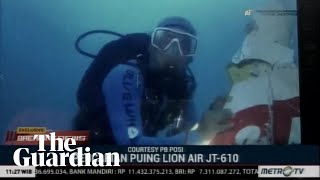 Divers collect debris from Lion Air wreckage