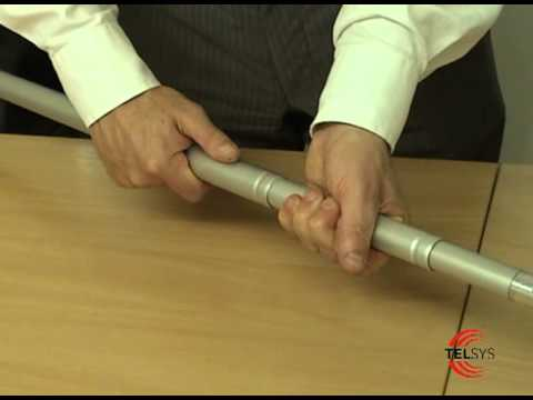 Internal twist action telescopic pole locking system