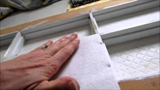 Putting fabric on the painted window frame