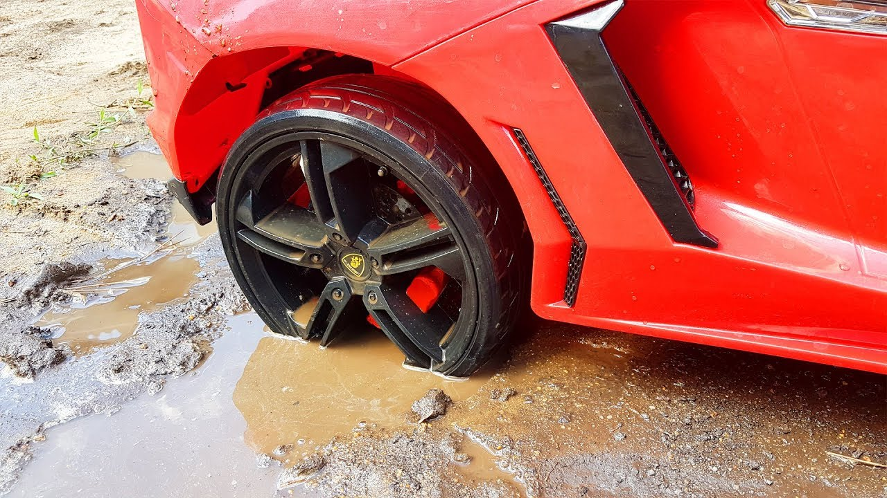 Red power wheels Lambo stuck in the mud