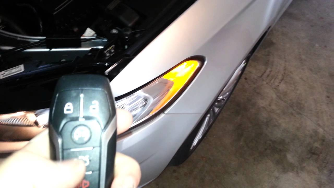 2014 ford fusion titanium sedan testing key fob after changing battery parking lights flashing