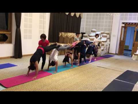 Group Yoga Class in Bhutan - Half Hand Stand Prep