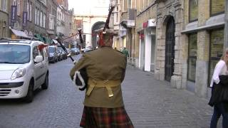 Marching with the Bagpipes toward the Menin Gate, Ypres