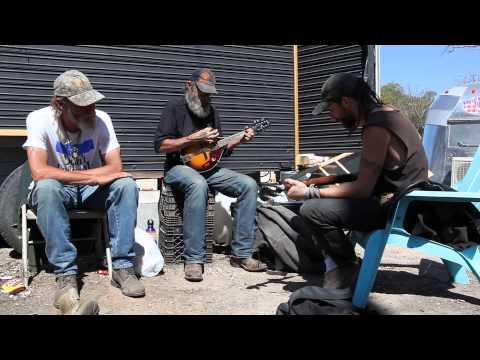 Guys jamming behind a food trailer on South 1st Street in Austin