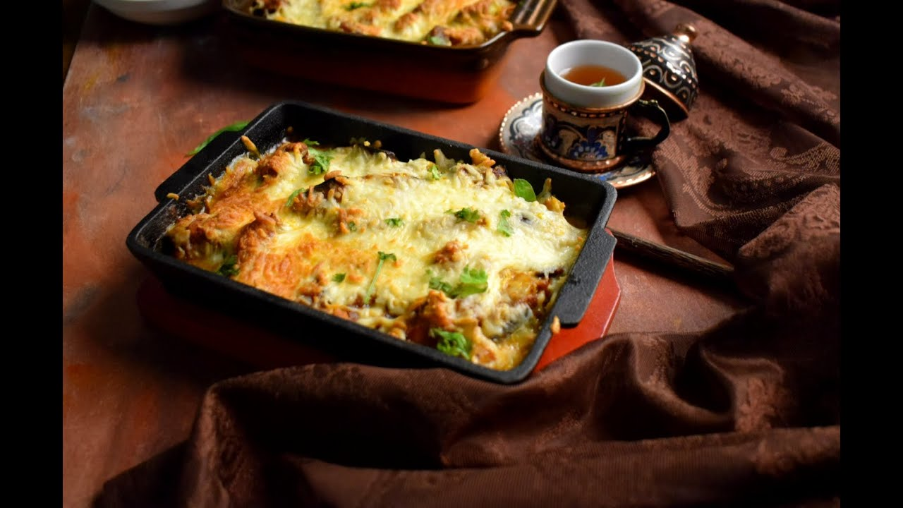 Turkish Guvec - A delicious Chicken & Veg stew loaded with gooey melted cheese is to die for! Enjoy!