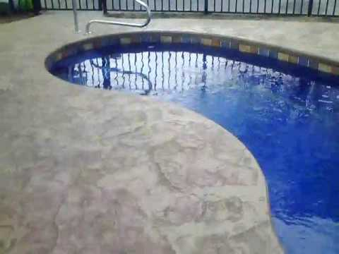 guide to stamped concrete around fiberglass pools