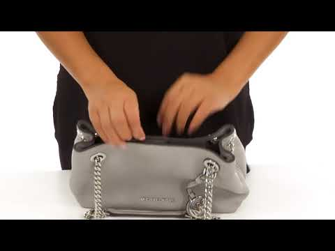 4c8ec8beaa175 The MICHAEL Michael Kors® Jet Set Chain Medium Messenger is sleek and edgy  while maintaining an air of class and sophistication. We absolutely cannot  get ...