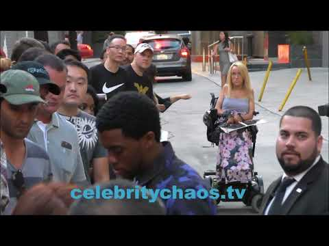 Chadwick Boseman Laughs With Fans While Signing Autographs Promoting Black Panther