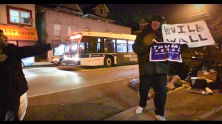 Lone Trump supporter heckles immigrants at candlelight vigil