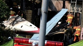 Three dead as small plane crashes into Tokyo suburb
