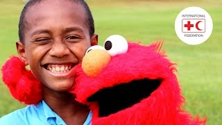 Elmo and Grover help Fiji children forget about Tropical Cyclone Winston