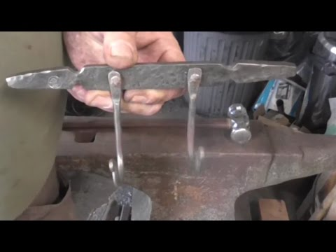 Hand forging a coathook with riveted hooks